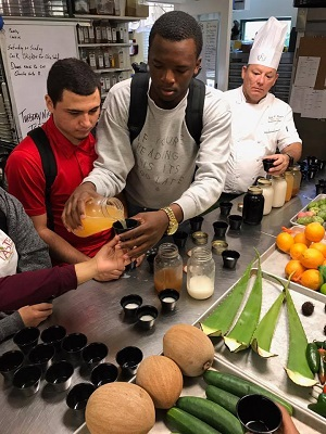Student entrepreneurs learning to make fresh juice